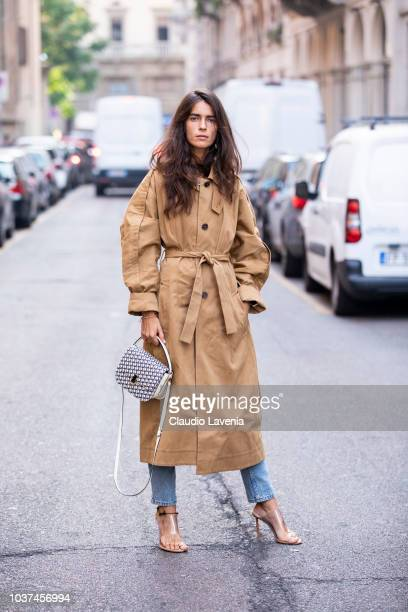 Chiara Totire wearing beige trench jacket and denim pants is seen before the Blumarine show during Milan Fashion Week Spring/Summer 2019 on September...