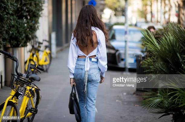 Chiara Totire wearing white blouse denim jeans is seen outside Dolce Gabbana during Milan Fashion Week Spring/Summer 2018 on September 24 2017 in...