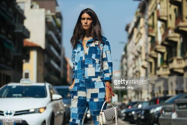 Chiara Totire wears a denim patchwork jumpsuit at Etro during Milan Fashion Week Spring/Summer 2019 on September 21 2018 in Milan Italy
