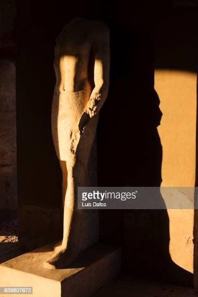 Chiaroscuro of pharaoh statue at Karnak temple