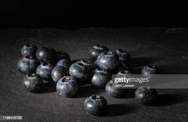 chiaroscuro still life study - blueberries - ripe stock pictures, royalty-free photos & images