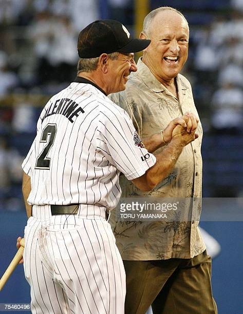 Major League Baseball legendary pitcher Nolan Ryan shares a laugh with Chiba Lotte Marines manager Bobby Valentine after throwing the ceremonial...
