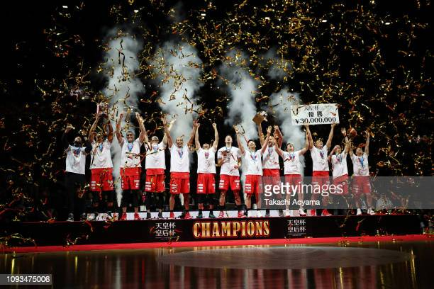 Chiba Jets players celebrate with the trophy and medals during awards ceremony following the Basketball 94th Emperor's Cup Final between Tochigi Brex...