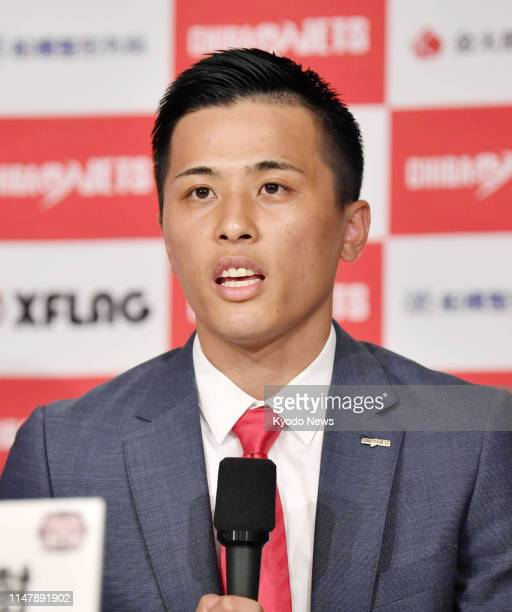 Chiba Jets point guard Yuki Togashi attends a press conference in Tokyo on June 3 as he becomes the first Japanese-born player to earn an annual...