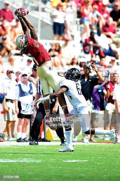 Chibuikem Okoro of the Wake Forest Demon Deacons defends a pass caught by Kelvin Benjamin of the Florida State Seminoles during a game at Doak...