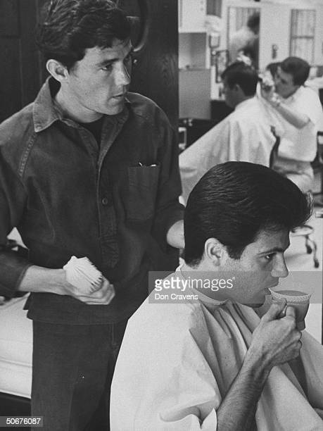 Chic barber Jay Sebring while working on singer Tommy Sands' hair.