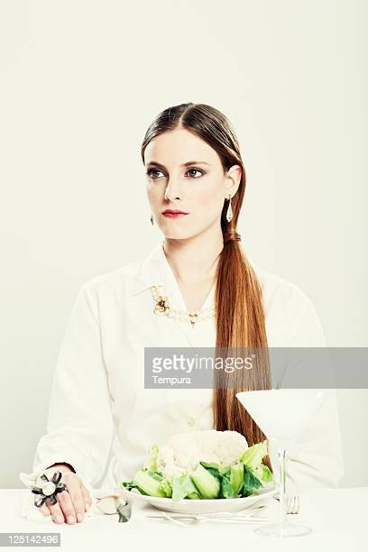 chic dinner, elegant woman dinning in a white atmosphere. - silver blouse stock pictures, royalty-free photos & images
