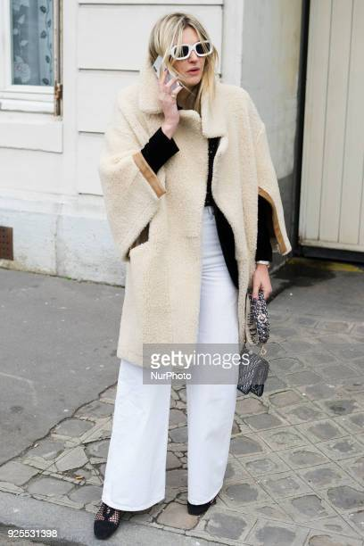 A chic showgoer attending the Christian Dior fashion show during Paris Fashion Week Fall/Winter 2018/19 in Paris France on 27 February 2018