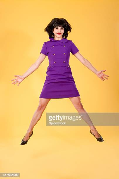 Chic Woman In Retro Dress Jumping