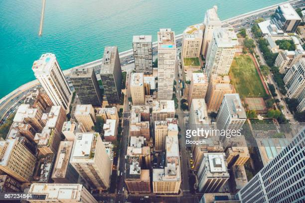 chicago aerial view of buildings lake michigan midwest usa - lake michigan stock pictures, royalty-free photos & images