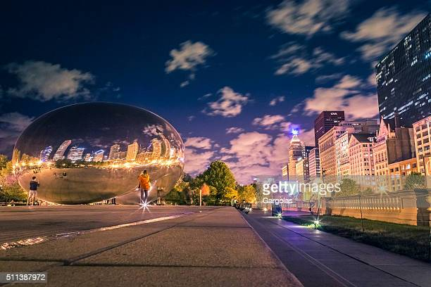 chicago at night - cloud gate stock photos and pictures