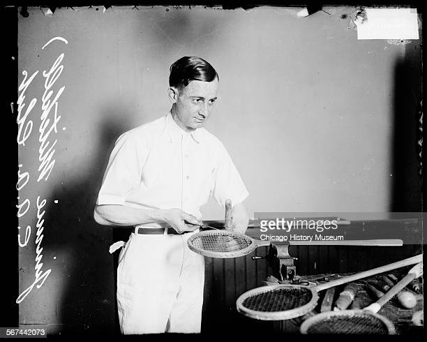 Chicago Athletic Association tennis player Jimmy Mitchell stringing a tennis racket Chicago Illinois 1920 The tennis racket is sitting in a vise grip...