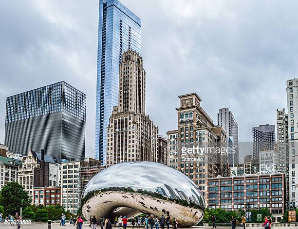 chicago bean in millennium park with reflection of skyscrapers - millenium park stock photos and pictures