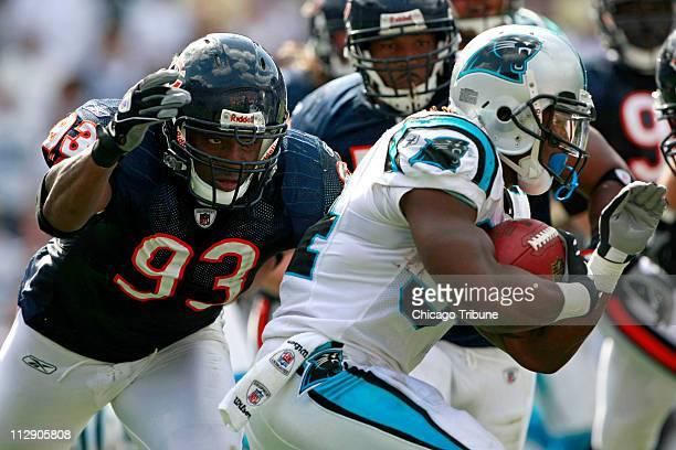 Chicago Bears Adewale Ogunleye eyes Carolina Panthers running back DeAngelo Williams in the fourth quarter at Bank of America Stadium in Charlotte...