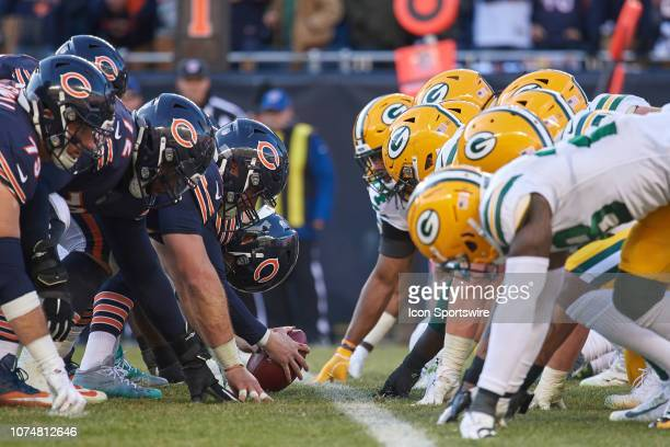 Chicago Bears and Green Bay Packers players line up at the line of scrimmage prior to the snap of the football in action during an NFL game between...