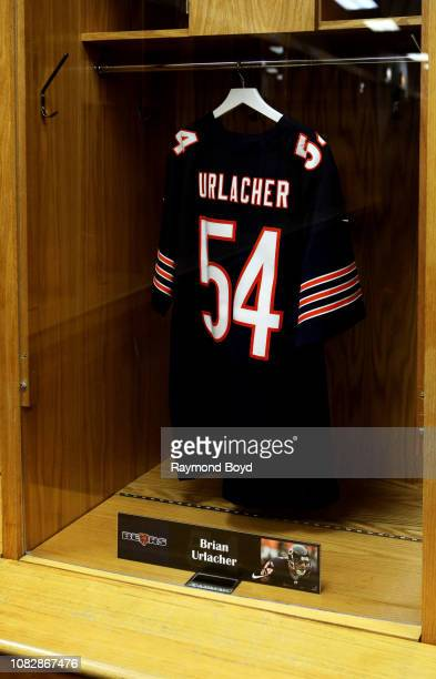 Chicago Bears Brian Urlacher football jersey hangs in the visiting team locker room at Soldier Field home of the Chicago Bears football team in...