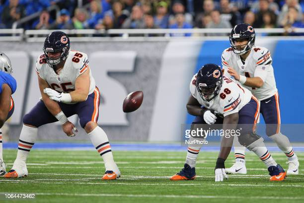 Chicago Bears center Cody Whitehair snaps the ball to quarterback Chase Daniel during the first half of an NFL football game against the Detroit...
