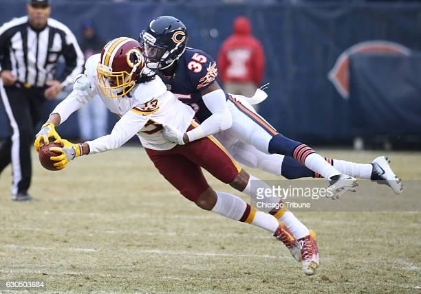 Chicago Bears cornerback Johnthan Banks and Washington Redskins wide receiver Maurice Harris during the second half at Soldier Field in Chicago on...