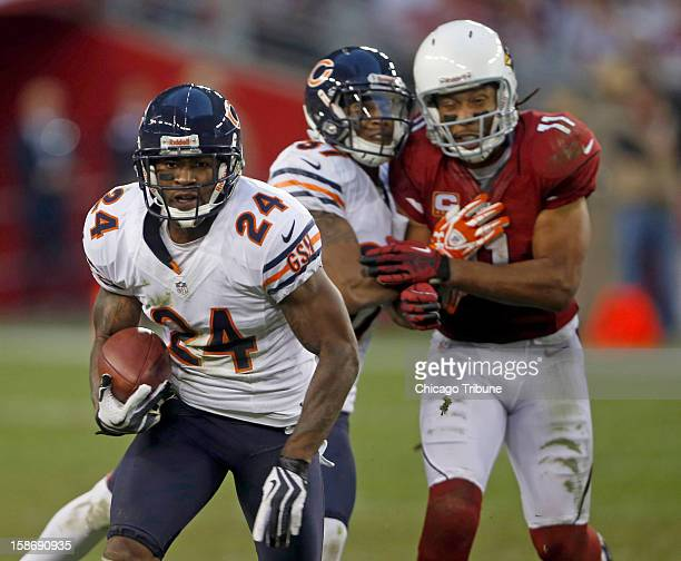 Chicago Bears cornerback Kelvin Hayden returns an interception against the Arizona Cardinals in the fourth quarter at University of Phoenix Stadium...