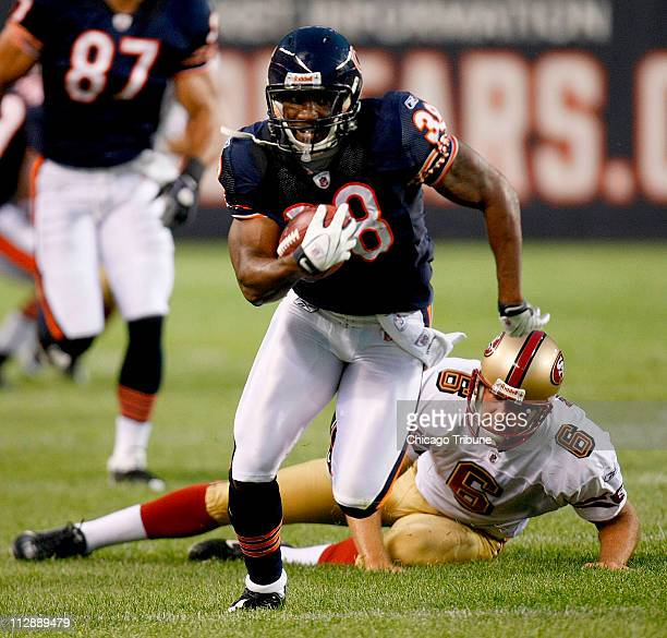 Chicago Bears' Danieal Manning returns a kickoff past San Francisco 49ers kicker Joe Nedney during a NFL preseason game at Soldiers Field in Chicago...