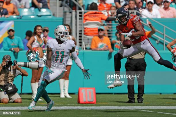 Chicago Bears defensive back Kyle Fuller intercepts a pass intended for Miami Dolphins wide receiver DeVante Parker late in the second quarter on...