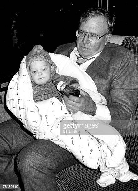 Chicago Bears defensive coordinator Buddy Ryan holds the son of club president Michael McCaskey and greatgrandson of team founder George Halas on the...