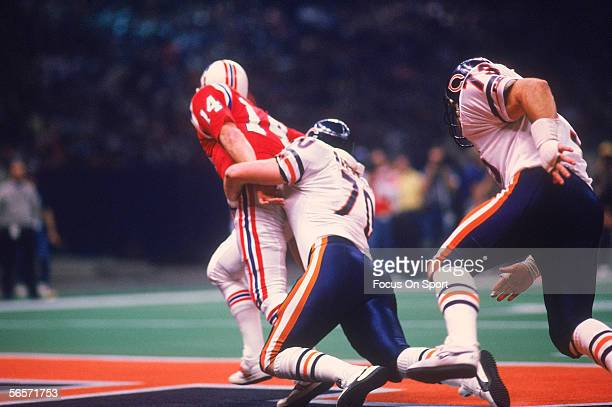 Chicago Bears' defensive end Henry Waechter sacks quarterback Steve Grogan of the New England Patriots in the end zone for a safety during Super Bowl...