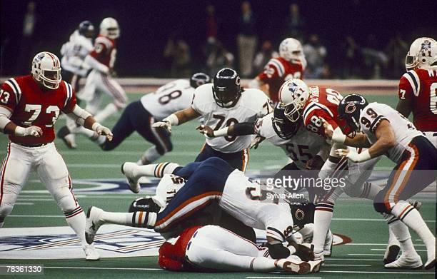 Chicago Bears defensive end Richard Dent and linebacker Wilber Marshall sack New England Patriots quarter back Steve Grogan during Super Bowl XX a...