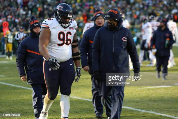 Chicago Bears defensive tackle Akiem Hicks is escorted off the field after being injured during a game between the Green Bay Packers and the Chicago...