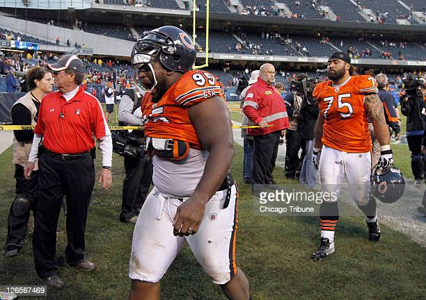 Chicago Bears defensive tackle Anthony Adams and right Chicago Bears defensive tackle Matt Toeaina walk off the field after a 2717 loss to the Green...
