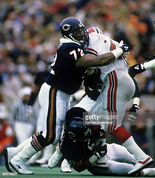 Chicago Bears defensive tackle William The Refrigerator Perry and Hall of Fame linebacker Mike Singletary stop Falcons running back Gerald Riggs...