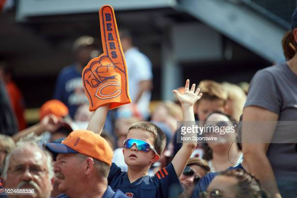 Chicago Bears fan holds a Chicago Bears hand with a Chicago Bears logo to celebrate during game action in a preseason NFL game between the Kansas...