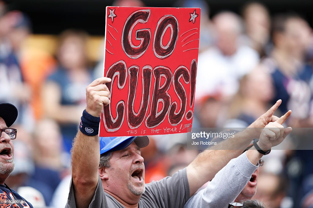A Chicago Bears fan shows support for the Chicago Cubs during the second half of the game against the Jacksonville Jaguars at Soldier Field on October 16, 2016 in Chicago, Illinois. The Jaguars defeated the Bears 17-16.