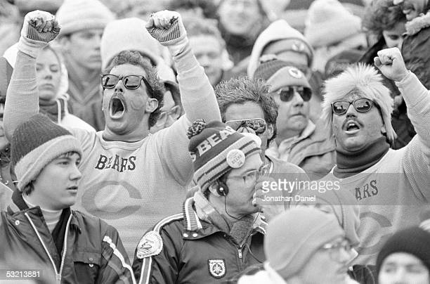 Chicago Bears fans cheer for their team during the 1985 NFC Championship game against the Los Angeles Rams at Soldier Field on January 12 1986 in...