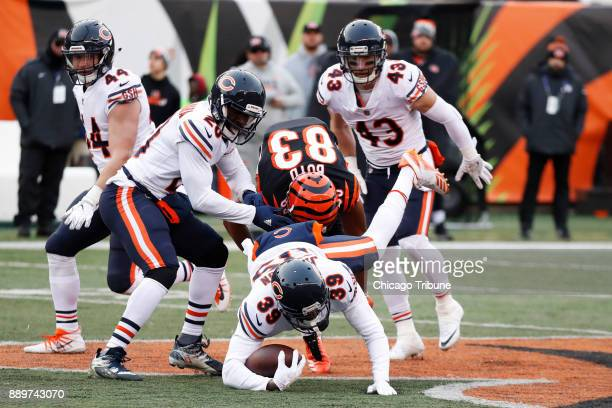 Chicago Bears free safety Eddie Jackson intercepts the ball as Cincinnati Bengals wide receiver Tyler Boyd tries to make the tackle in the third...