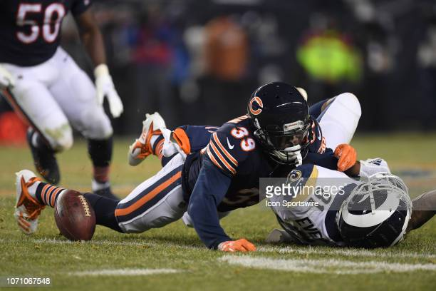Chicago Bears free safety Eddie Jackson tackles Los Angeles Rams tight end Gerald Everett in action during an NFL game between the Los Angeles Rams...
