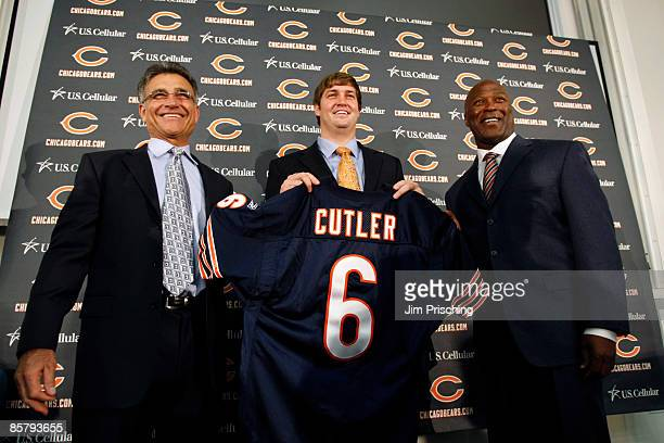 Chicago Bears general manager Jerry Angelo quarterback Jay Cutler and head coach Lovie Smith are all smiles after introducing Cutler as their new...