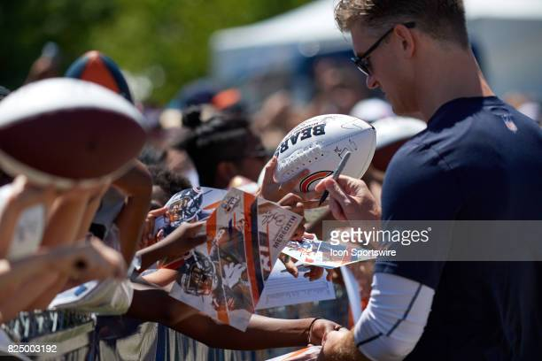 Chicago Bears General Manager Ryan Pace signs autographs for fans after a practice session during the Chicago Bears Training Camp on July 29 2017 at...