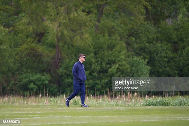 Chicago Bears General Manager Ryan Pace walks on the field during the Bears team OTA workouts on May 23 2017 at Halas Hall in Lake Forest IL
