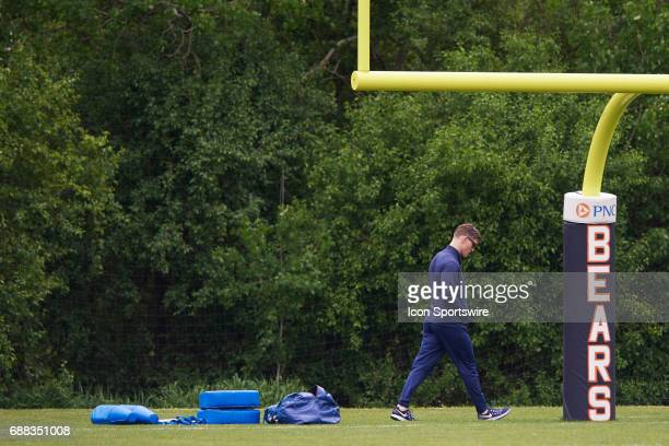 Chicago Bears General Manager Ryan Pace walks past a goal post during the Bears team OTA workouts on May 23 2017 at Halas Hall in Lake Forest IL