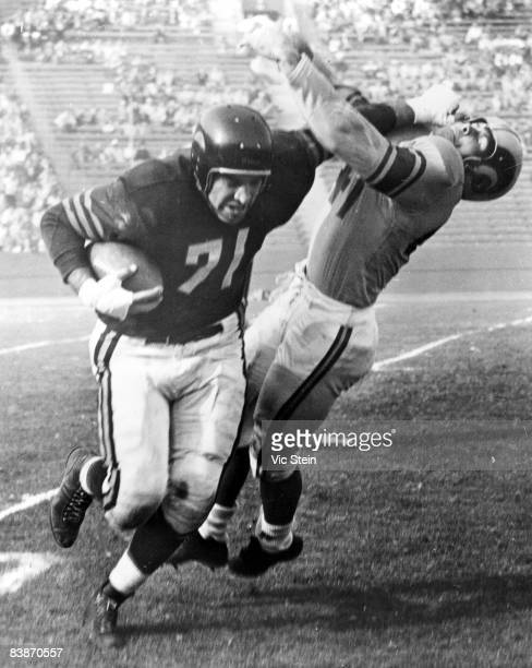 Chicago Bears Hall of Fame offensive tackleoutside linebacker George Connor straight arms a Los Angeles Rams defender in a 1950s game at the Los...