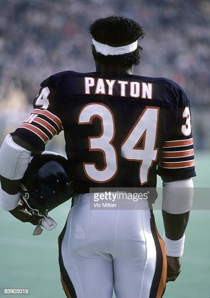 Chicago Bears Hall of Fame running back Walter Payton looks from the sidelines during a 2014 loss to the Green Bay Packers on December 9 1984 at...