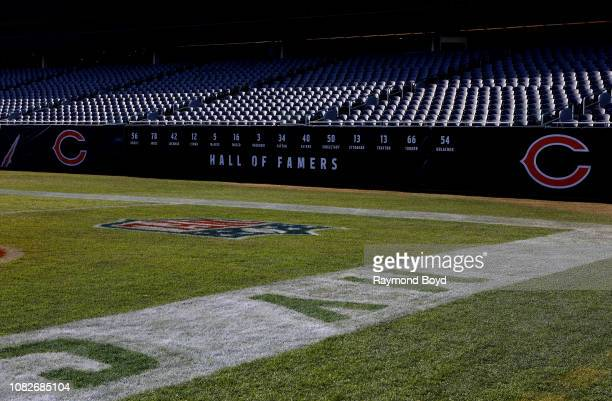 Chicago Bears 'Hall Of Famers' numbers are displayed along the sidelines at Soldier Field, home of the Chicago Bears football team in Chicago,...