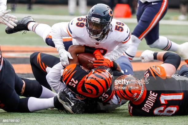Chicago Bears inside linebacker Danny Trevathan tackles Cincinnati Bengals running back Giovani Bernard in the first quarter on Sunday Dec 10 2017 at...