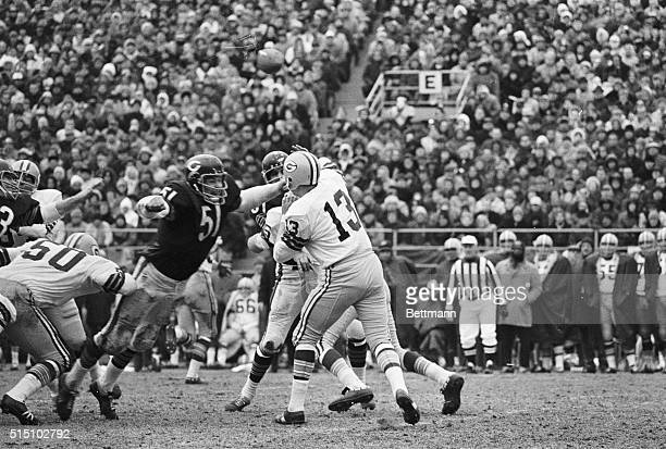 Chicago Bears linebacker Dick Butkus is ready to tackle Green Bay quarterback Don Horn just as Horn releases the ball