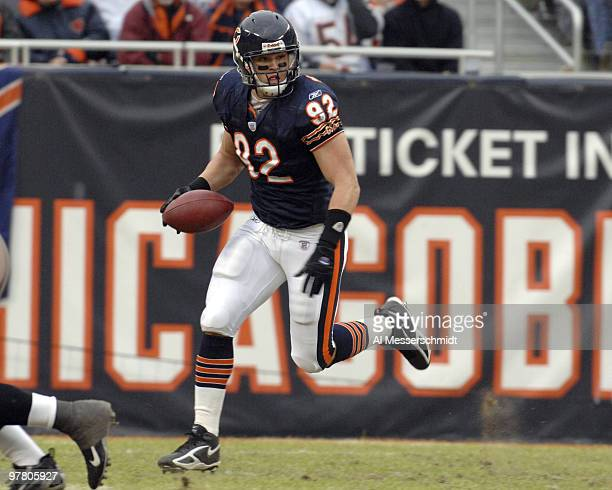 Chicago Bears linebacker Hunter Hillenmeyer grabs a loose ball against the Tampa Bay Buccaneers Dec 17 2006 at Soldier Field in Chicago The play was...