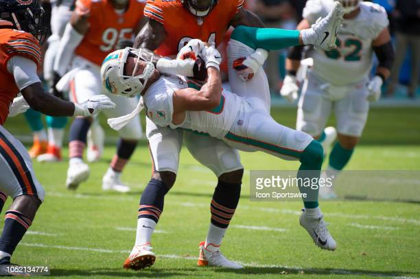 Chicago Bears Linebacker Leonard Floyd picks up Miami Dolphins Wide Receiver Danny Amendola flipping him upside down resulting in a personal foul...