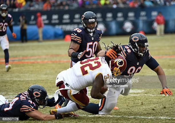 Chicago Bears Linebacker Nick Kwiatkoski Linebacker Jerrell Freeman and Defensive End Akiem Hicks rush in to tackle Washington Redskins Running Back...