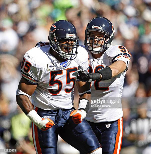 Chicago Bears linebackers Lance Briggs and Hunter Hillenmeyer celebrate after Briggs' sacked Seattle Seahawks quarterback Seneca Wallace in the...