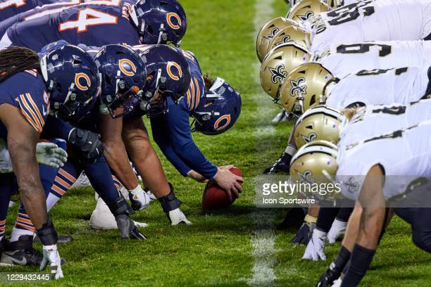 Chicago Bears offensive line sets up across the New Orleans Saints defensive line at the line of scrimmage in action during a game between the...